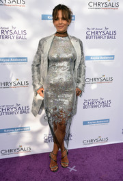 Halle Berry added more shimmer with a silver coat by Yeon.