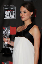 The 'Black Swan' star showed off her 2011 Critics Choice Award, the better to see her 19th Century diamond bracelet.