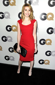 Emma Roberts paired her sophisticated red sheath with an oversize black leather clutch at the 'GQ' Men of the Year party.