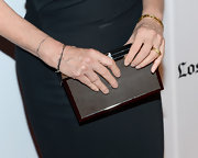 Susan Sarandon showed off some major hardware with this silver hard case clutch.