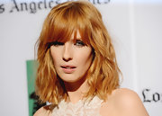 Kelly's blunt bangs and shoulder-length waves made for a high-fashion statement 'do.