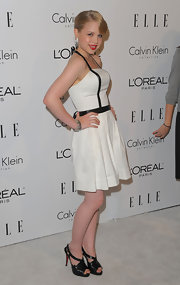 Sofia looked darling in a white cocktail dress with leather trim. Black Louboutins complete her chic look.