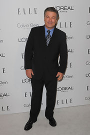 Alec Baldwin paired his button down blue shirt with a striped tie and classic suit.