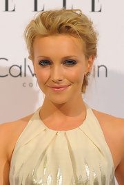 Katie Cassidy amped up her loose bun with a dramatic application of metallic gunmetal shadow.