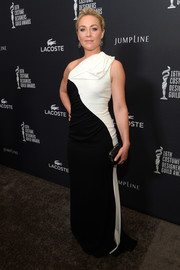 Elisabeth Rohm exuded modern elegance at the Costume Designers Guild Awards in a black-and-white one-shoulder gown by Badgley Mischka.