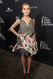 Kiernan Shipka chose a pair chic black lace pumps by Nicholas Kirkwood to complete her look.