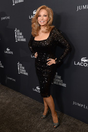 Raquel Welch showed off her amazing physique in a skintight beaded black dress during the Costume Designers Guild Awards.