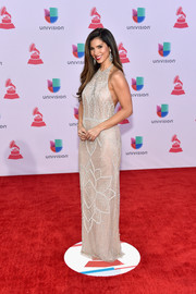 Roselyn Sanchez looked gorgeous in a beaded silver halter gown during the Latin Grammy Awards.