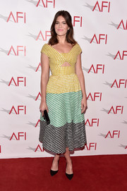 Mandy Moore exuded '50s charm wearing this yellow, green, and black fit-and-flare dress with a midriff cutout at the AFI Awards.