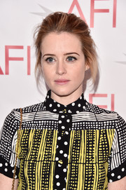 Claire Foy attended the AFI Awards wearing her hair in a loose, messy updo.