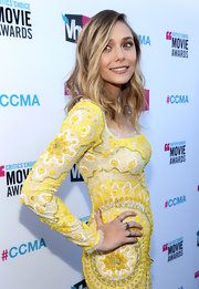 Elizabeth Olsen wore an Alice Rose ring of pink beryl and diamonds at the 17th Annual Critics' Choice Movie Awards.