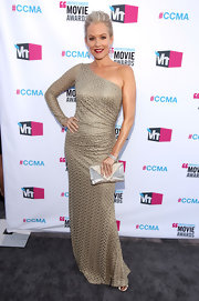 Penelope Ann Miller accented a striking single-sleeved dressed with a mixed metal envelope clutch.