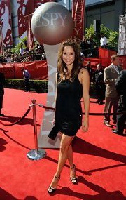 Brooke hit the red carpet in a loose LBD and beachy waves. Her bangs are loosely pinned back for added volume.