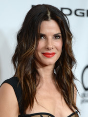 A swipe of red lipstick totally brightened up Sandra Bullock's look during the Hollywood Film Awards.