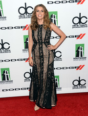 Carly Steel looked chic and feminine in a nude and black lace gown during the Hollywood Film Awards.
