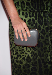 Olivia Munn paired her bold dress with a simple gray hard-case clutch by Fendi when she attended the Hollywood Film Awards.