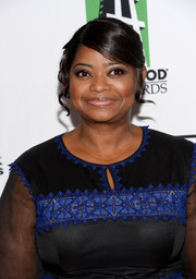 Octavia Spencer styled her hair in pinned-up ringlets with side-swept bangs for the Hollywood Film Awards.