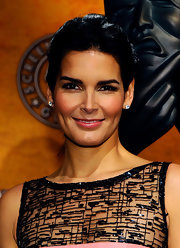 Angie Harmon completed her elegant look with sparkling diamond stud earrings.