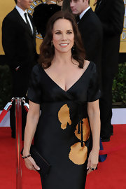 Barbara Hershey complemented her silk floral dress with a sleek black silk clutch with gold hardware.