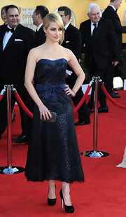Dianna Agron added shimmer to her ladylike SAG Awards look with a silver beaded Minaudière clutch.