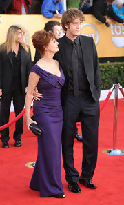 Susan Sarandon complemented her purple gown with an eggplant satin clutch.
