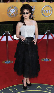 "Helena Bonham Carter competed her SAG Awards look with a black pearl-adorned clutch emblazoned with the words ""Pearls of Wisdom."""