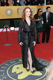 Christina Hendricks paired her tuxedo dress with black lace Rene Caovilla peep toes.