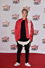 Justin Bieber teamed a red 'Budweiser' bomber jacket with black skinny pants for the 2015 NRJ Music Awards.