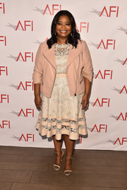 Sticking to a neutral palette, Octavia Spencer styled her look with a pair of snakeskin sandals.
