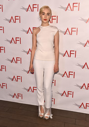 Saoirse Ronan sealed off her all-white look with a pair of platform peep-toes by Jimmy Choo.