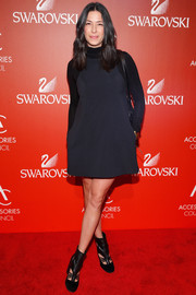 Rebecca Minkoff styled her dress with edgy black cutout boots.
