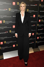 Jane wears a classic pantsuit with wide legs and black flats to the Britannia Awards.