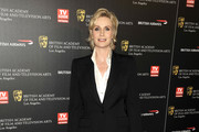 Jane Lynch poses for a picture at the 18th annual BAFTA Los Angeles Britannia Awards held at the Hyatt Regency Century Plaza Hotel on November 4, 2010 in Los Angeles, California.