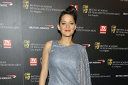 Marion Cotillard poses for a picture at the 18th Annual BAFTA Britannia Awards held at the Hyatt Regency Century Plaza Hotel on November 4, 2010 in Los Angeles, California.