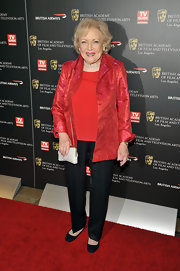 Betty looks lovely in this red evening jacket with a subtle iridescent embossing pattern.