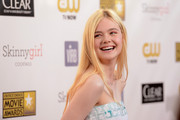 Actress Elle Fanning arrives at the 18th Annual Critics' Choice Movie Awards held at Barker Hangar on January 10, 2013 in Santa Monica, California.