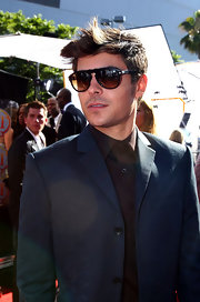 Zac looked stylish in cool dark shades and a spikey do.
