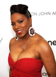 Niecy went for a bold look with these intricately beaded and over-sized dangle earrings.