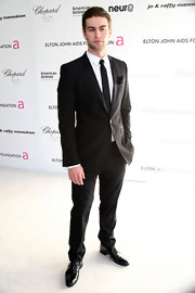 Chace took a classic approach to his look with a black suit and matching tie.