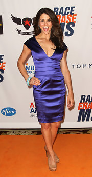 Samantha Harris shined at the Race to Erase MS Gala in a royal purple satin cocktail dress.