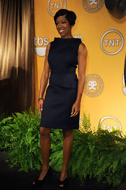 Regina King wore a crisp charcoal sheath dress with a boatneck and asymmetrical peplum for the SAG Nominations.