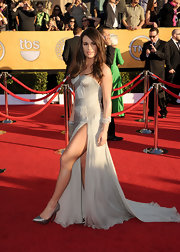 Lea Michele topped off her sexy Versace gown with metallic stilettos.