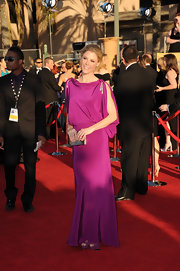 Julie was lovely on the red carpet, wearing a deep-pink cocktail dress complete with draped sleeves.