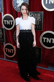 Emilia Clarke wore a black and white feather creation for the SAG Awards.