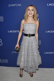 Kiernan Shipka rounded out her look with a metallic silver clutch, also by Jimmy Choo.