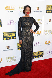 Aisha Tyler exuded classic elegance at the Critics' Choice Awards in a long-sleeve black lace gown by Tadashi Shoji.
