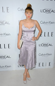 Zoe pulled a Lara Stone in this silver spaghetti strap slip-dress at the Women in Hollywood Celebration.