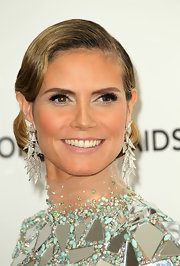 Heidi Klum added even more glitz to her look with tiered triangle diamond earrings.