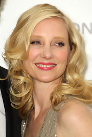 Anne Heche completed her glamorous look with side swept curls.
