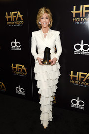 Jane Fonda looked very polished in a white Balmain gown, featuring a tiered skirt and a wrap bodice with a lace underlay, at the Hollywood Film Awards.